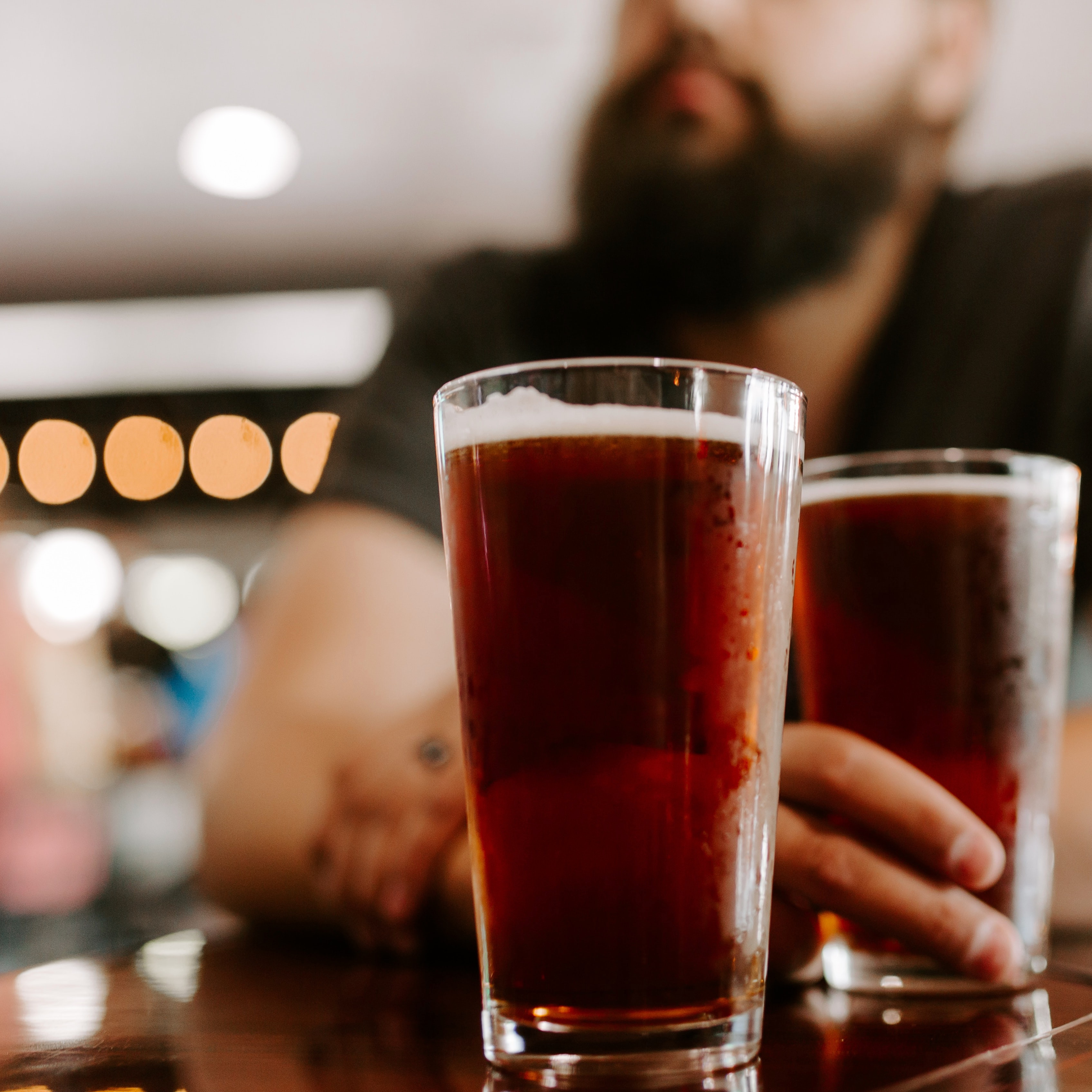 Dry Drinker Wholesale Man sitting with two drinks in a bar